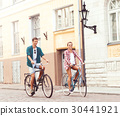 Happy traveling couple riding on bicycles 30441921