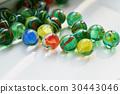 Bright glass multicolored stones round . 30443046