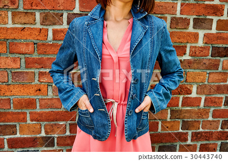 style. Girl in pink dress and denim jacket on 30443740