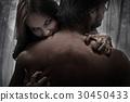 Portrait of a female vampire biting a victim 30450433