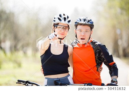Young cyclists in protective helmets 30451632