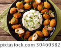 Tasty breaded fried olives with almonds 30460382