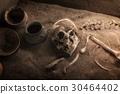 Ancient skeleton lying in grave 30464402