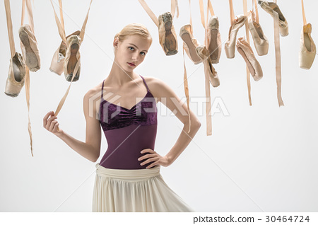Blonde ballerina and pointe shoes 30464724