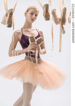 Blonde ballerina with pointe shoes 30464725