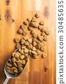 Dry kibble dog food in scoop. 30485635