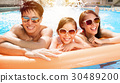 Happy family playing in swimming pool 30489200