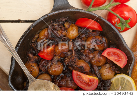 Baby cuttle fish roasted on iron skillet 30493442