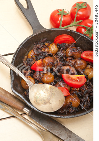 Baby cuttle fish roasted on iron skillet 30493445