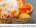 Italian snail lumaconi pasta with tomatoes 30493489