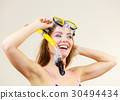 Woman with snorkeling mask having fun 30494434