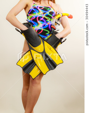 Woman with flippers and snorkeling mask 30494443