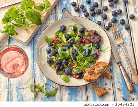 Healthy salad with rocket and blueberries 30494803