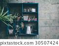 blue shelves decoration on a brick background 30507424
