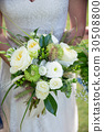 Bride Holding Wedding Bouquet 30508800