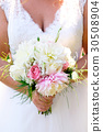 Bride Holding Wedding Bouquet 30508904