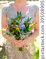 Bride Holding Wedding Bouquet 30508905