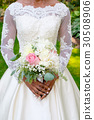 Bride Holding Wedding Bouquet 30508906