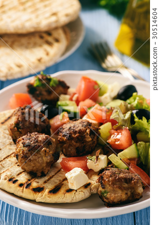 Greek meatballs (keftedes) with pita bread. 30514604