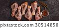 Raw chicken legs, top view. 30514858