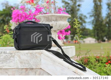 black  bag on banister marble floor in the park 30517140