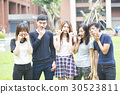 Selfie! teenagers taking pictures in the city 30523811