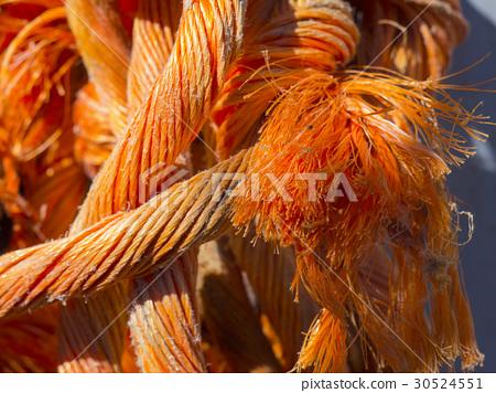 bright orange rope strangely intertwined close up 30524551
