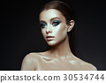 Fashion model Woman with fantasy make up. Long 30534744