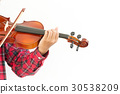 Young man playing violin in isolated background. 30538209