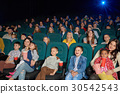 Children watching movies at the cinema 30542543
