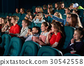 Children watching movies at the cinema 30542558