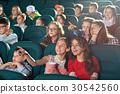 Cinema auditorium full of kids during movie 30542560