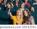 Cinema auditorium full of kids during movie 30542561