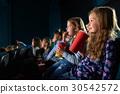Children watching movies at the cinema 30542572