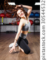Young fitness woman doing aerobic dance exercise 30544532