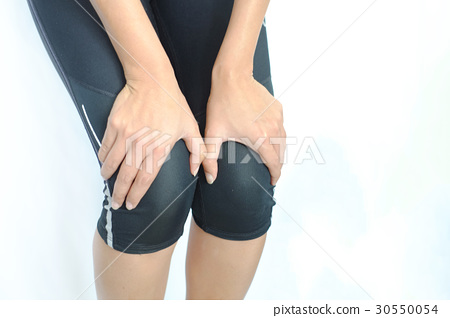 Woman  with knee pain and  hand on her knee, 30550054