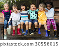 Group of kindergarten kids friends arm around sitting and smiling fun 30556015