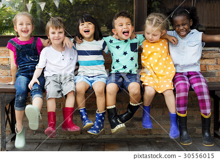 Group of kindergarten kids friends arm around sitting and smiling fun 30556015