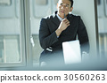 the businessman is thinking about something. 30560263