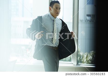 the businessman is wearing the suit. 30560283