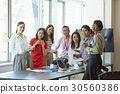 A portrait of seven smiling people at office 30560386