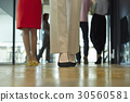 Legs of people standing in the office. 30560581