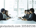 A portrait of a meeting in office. 30560596