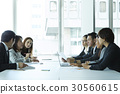 A group is discussing a new strategy in office. 30560615