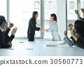 a portrait of a congratulation on two women shaking hands 30560773