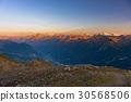 Warm light at sunrise on mountain peaks 30568506