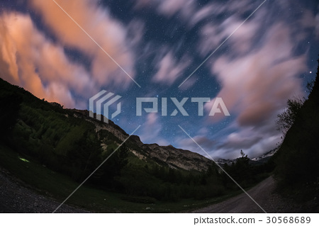 The starry sky with blurred motion clouds 30568689