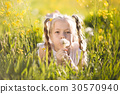 Little blonde girl with dandelion flower 30570940