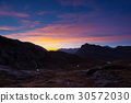 Mountain silhouette and stunning sky 30572030