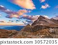Last warm sunlight on alpine valley  30572035